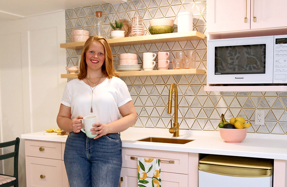 Virginia Fynes in pink kitchen she desgined