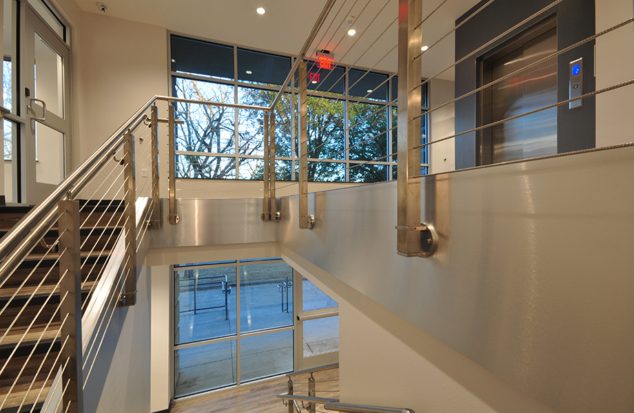 DecoMetal® Laminate Shines in Award-Winning Design by Wright Group Architects: staircase with Brushed Aluminum DecoMetal®