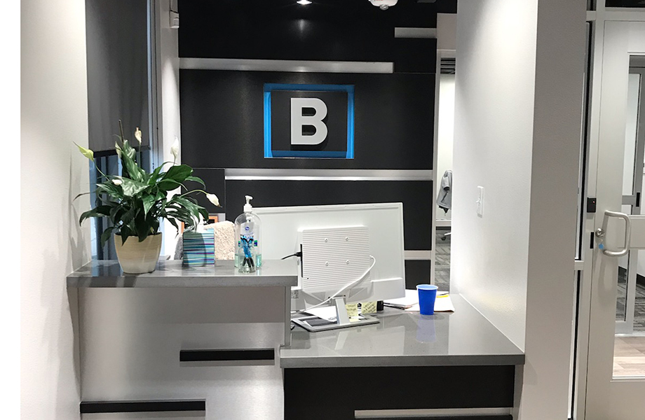 DecoMetal® Laminate Shines in Award-Winning Design by Wright Group Architects: Brushed Black Aluminum DecoMetal® is used in the law office lobby to highlight the company's logo on the wall and the reception desk.