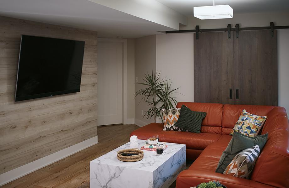 Planked Coffee Oak Barn doors behind orange couch
