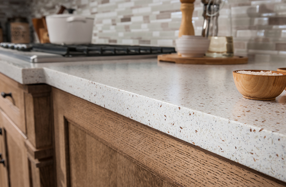 742 Blanco Terrazzo acrylic solid surface countertop in kitchen with wood cabinetry