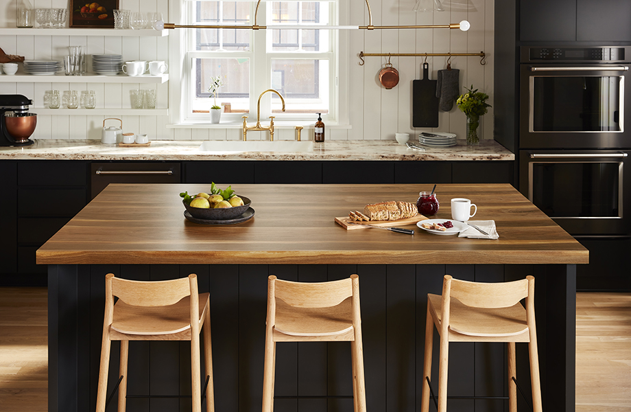 Wide Planked Walnut kitchen island countertops with snacks and River Gold kitchen countertops