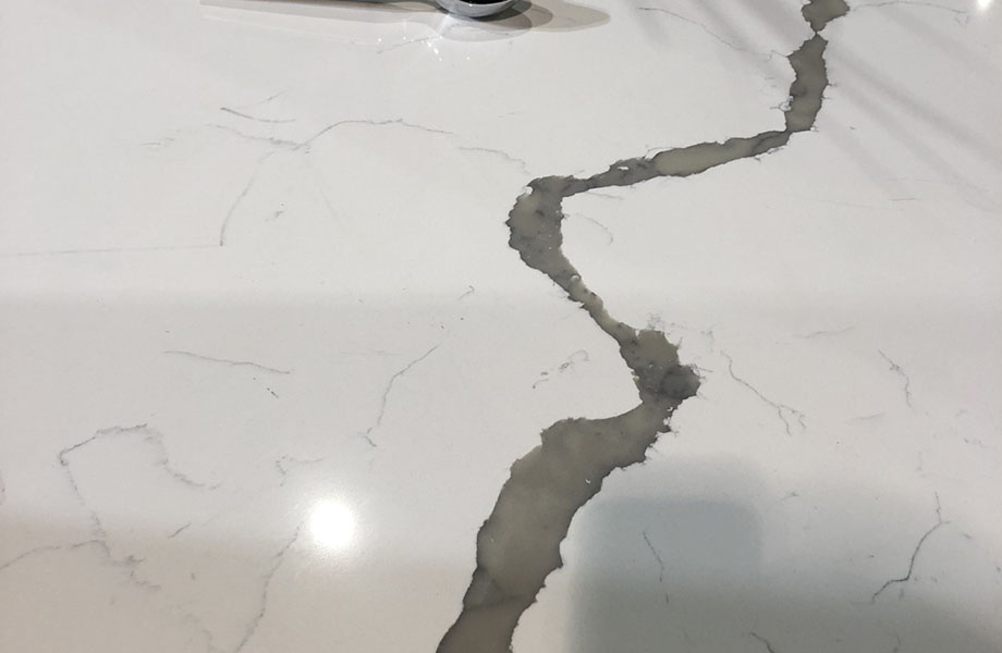 A striking, veined pattern at Kohler, KBIS 2019, KZ Kitchen Cabinet and stones