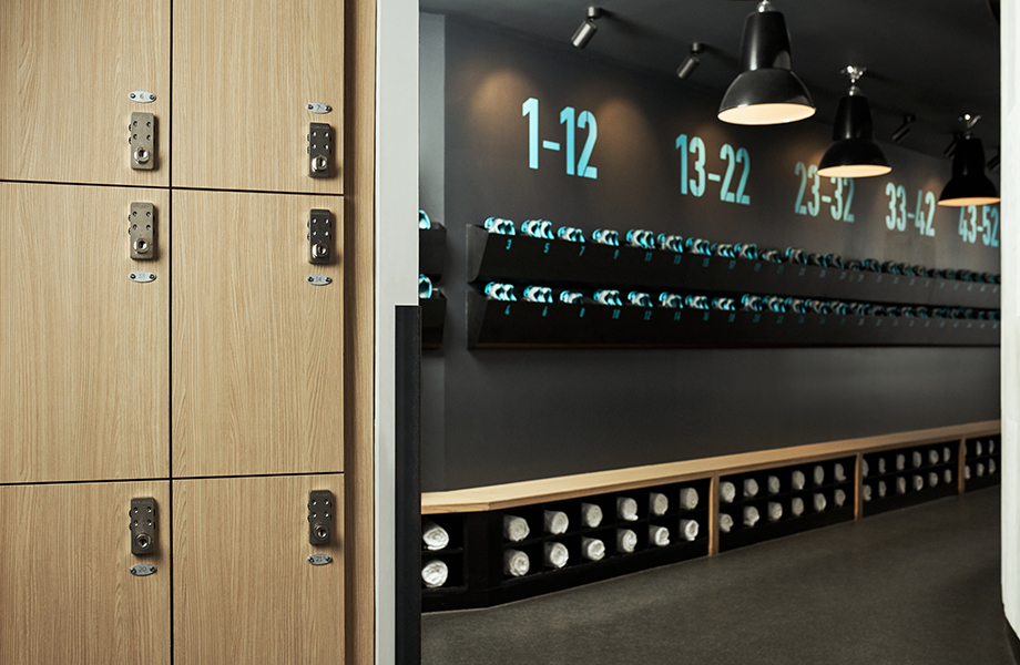 Flywheel locker room with Aged Ash Formica Laminate lockers