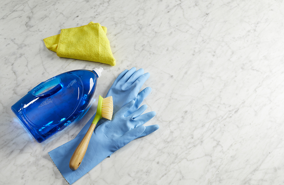 cleaning laminate with scrub brush and dish soap