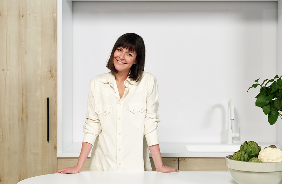 Leanne Ford, pictured here with cabinetry made with 7412 Planked Raw Oak Formica® Laminate