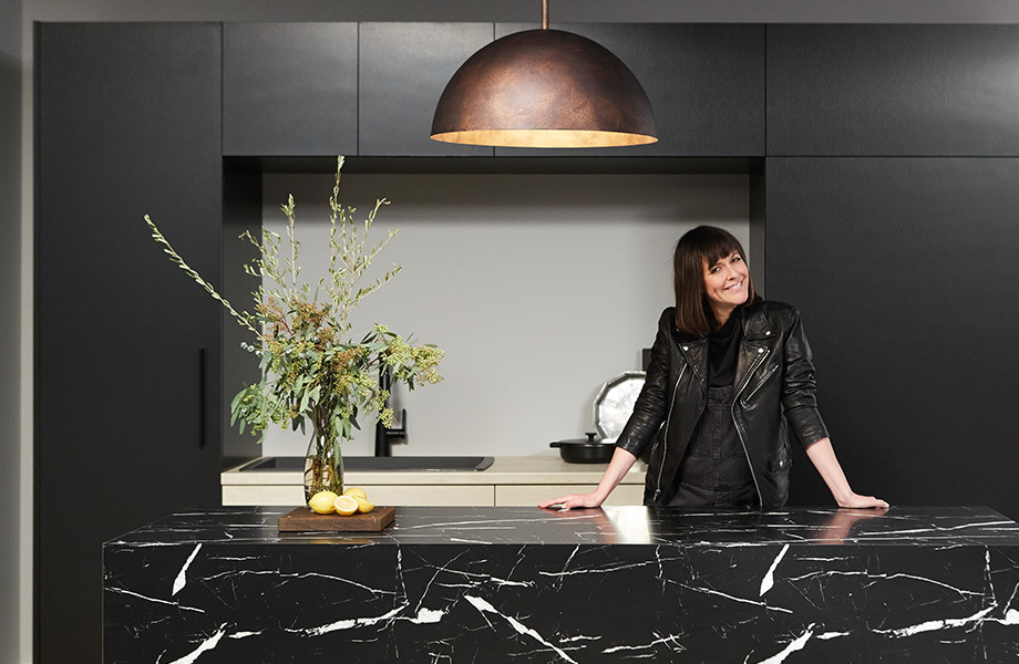 Leanne Ford, pictured here with an island covered in 7403 Nero Marquina 180fx® by Formica Group laminate.