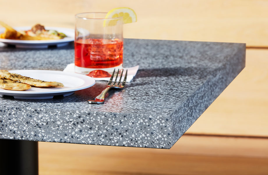 411 Grafite Terrazzo Matrix Restaurant acrylic countertop dining table with appetizers and drinks