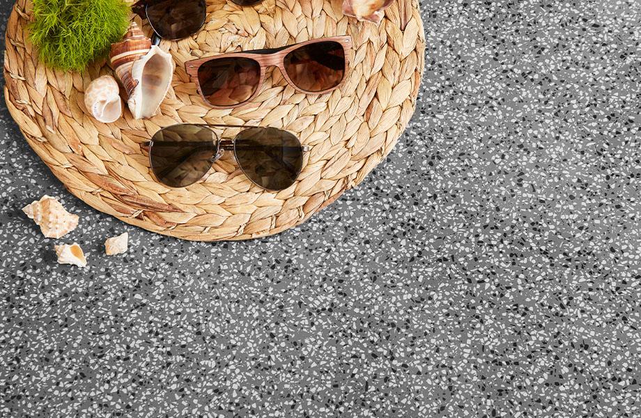 411 Grafite Terrazzo Matrix solid surface gray countertops with retail display of sunglasses