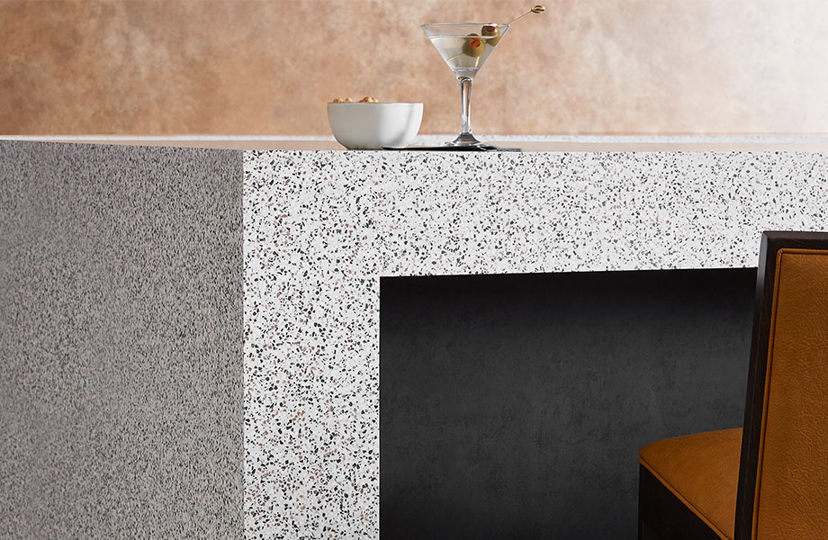 412 Dalmata Terrazzo Matrix table with drink and M9422 Black Patina solid metal beneath