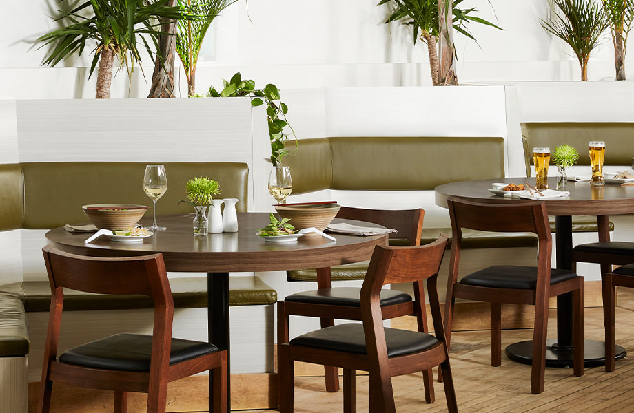 Restaurant with 5784-NG Ashwood Bone booths and 5789-43 Clove Spice Cherry tables