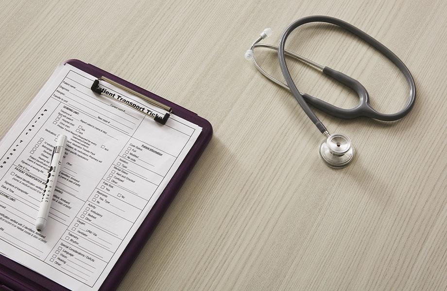 Healthcare design featuring 5784-NG Ashwood Bone woodgrain laminate desk with stethoscope