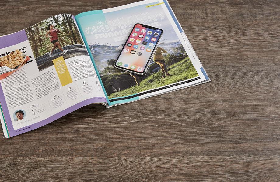 8589-PG Tula Oak woodgrain countertop laminate with magazine and phone