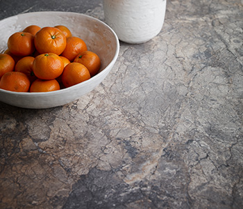 Oranges in a bowl on countertop 7405 Istanbul Marble 180fx