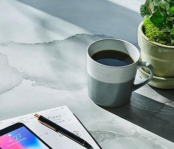 The 2020 Living Impressions™ Laminate Collection by Formica Group: table surface with 180fx® Laminate 5016-11 Watercolor Porcelain with coffee cup