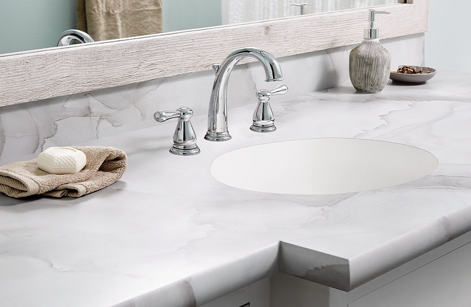 Bathroom vanity countertop made with Formica® HPL laminate 180fx® 5016-11 Watercolor Porcelain - a soft blend of gray and beige, creating pockets of colour in the translucent overlaps.