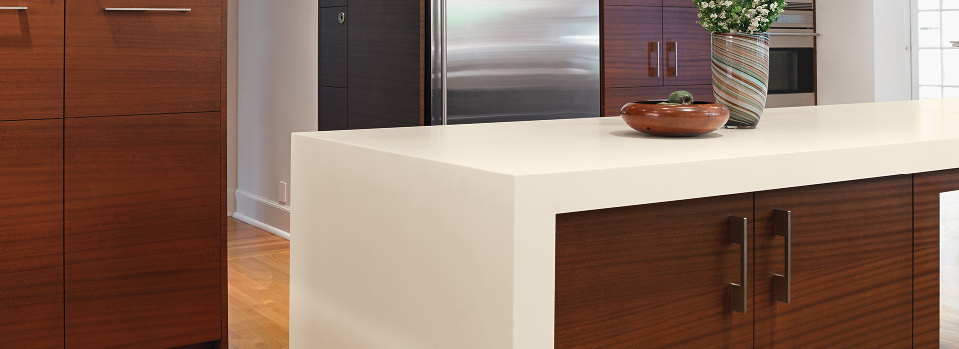 Flowers and bowl on kitchen countertop 773 Luna Sail White Formica Solid Surfacing