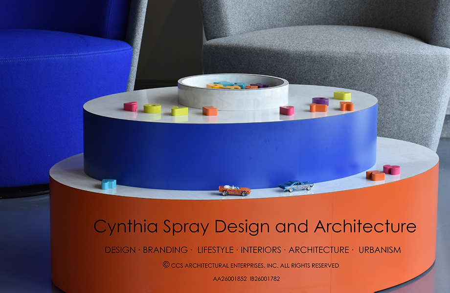 Close-up of Cynthia Spray designed circular table in Clementine and Spectrum Blue Formica laminate