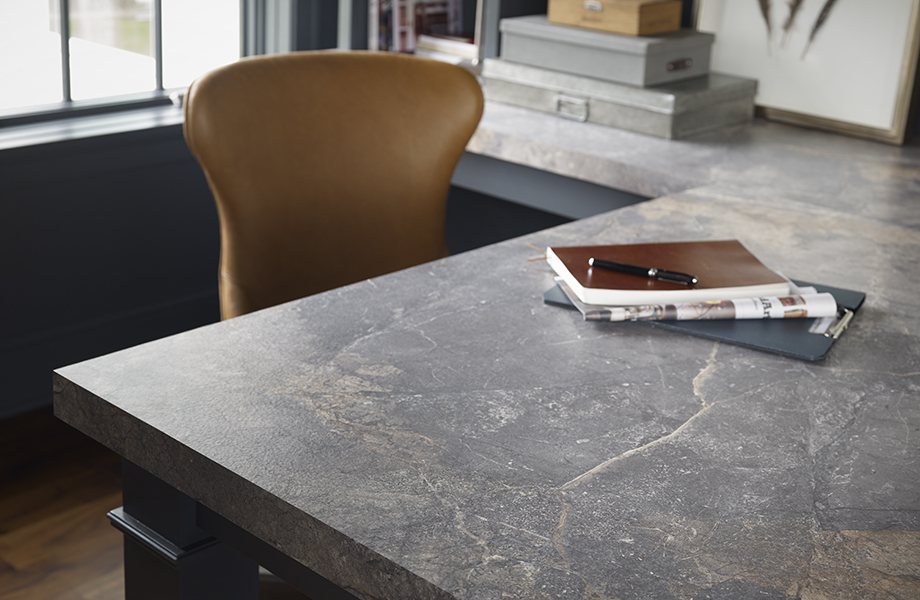 Home office with Formica® Laminate 7405-34 Istanbul Marble desktop with notebook and chair