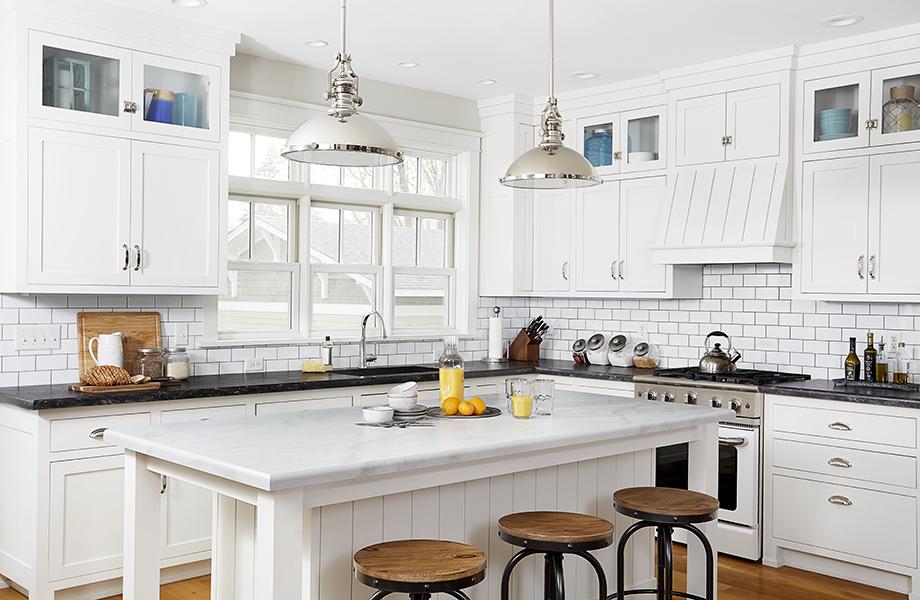Tuxedo kitchen with white laminate Calacatta Cava island countertops and Black Bardiglio laminate countertops