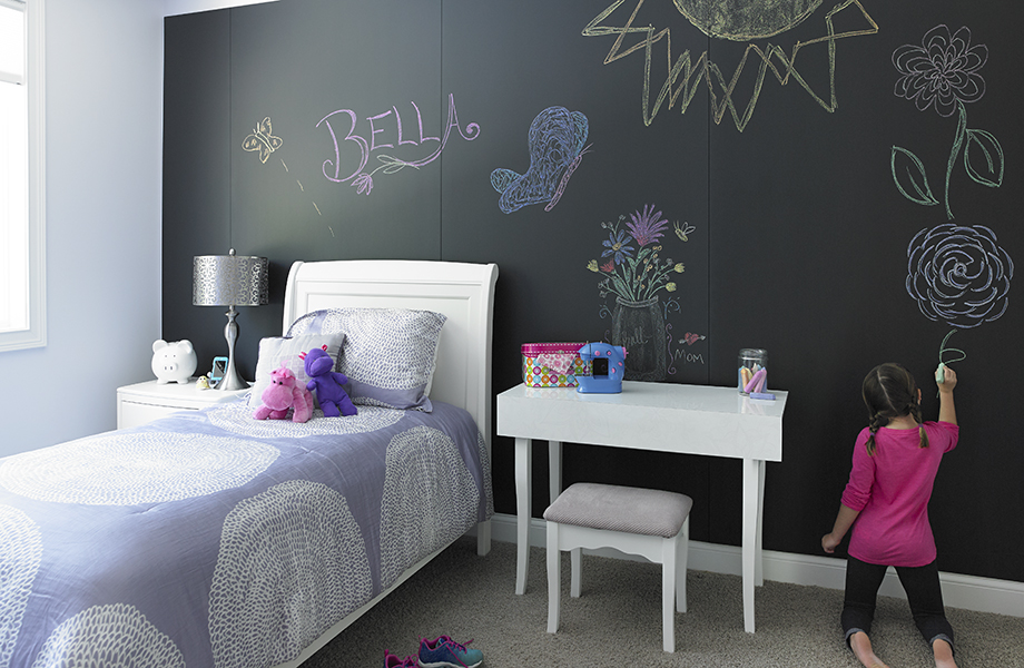 Girl draws on bedroom wall with F3037 Black ChalkAble Formica Writable Surfaces near bed and desk