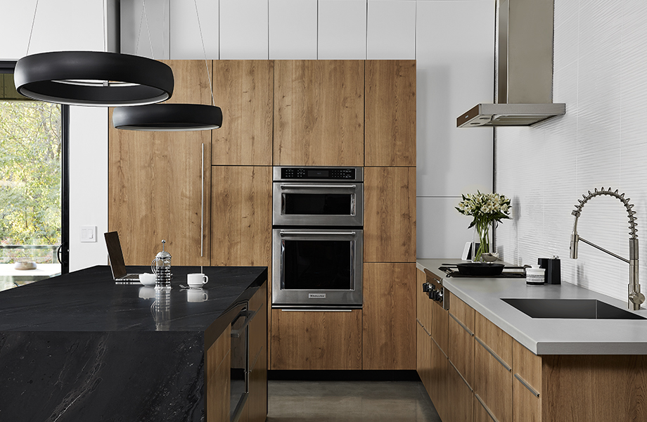 Contemporary kitchen with 5015-11 Black Painted Marble and 9319-BH Stainless countertops with 9312-NG Planked Urban Oak cabinets