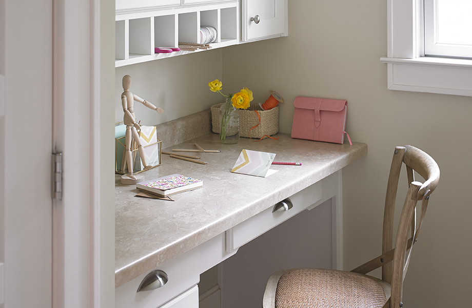 Desk tucked in nook with 3526 Travertine surface with chair and note cards