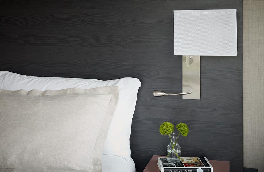 Hotel bed with pillows and 1547-PG Noir Cedar woodgrain laminate headboard
