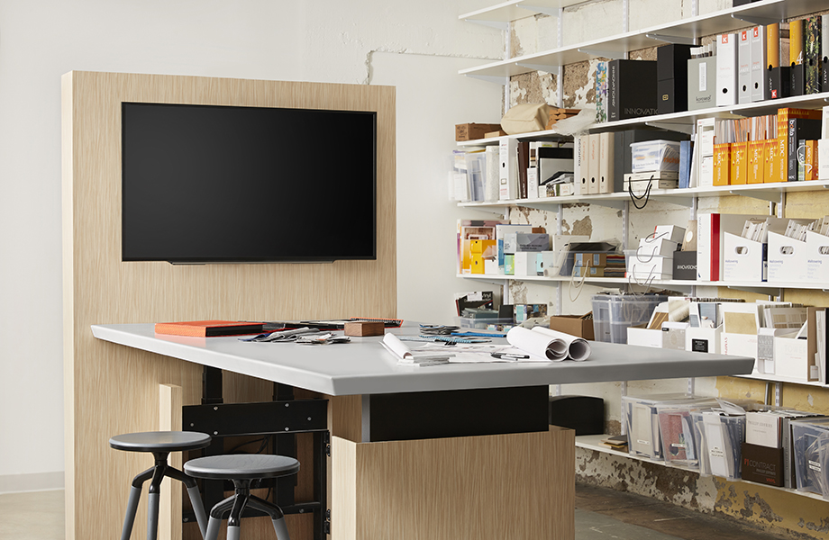 Office workspace with 6212-58 Wheat Strand panels, monitor and 417 Gamma Gray solid surface countertop