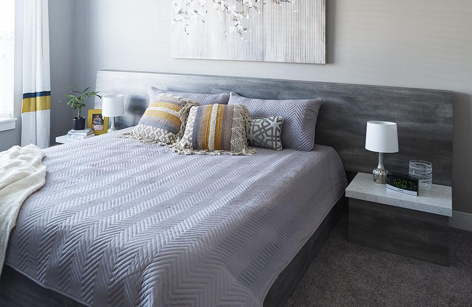 Bed with 9524-NG Umbra Oak gray woodgrain laminate headboard and 9525-34 White Shalestone nightstand top