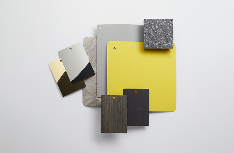 Collection of Formica laminate samples in gray and yellow with metallics