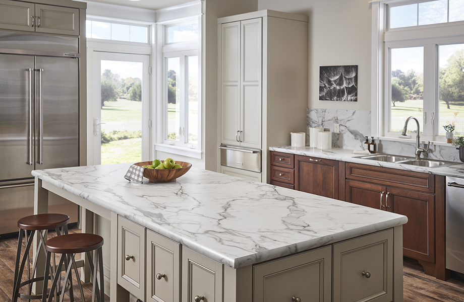 Light and bright kitchen with 3460 Calacatta Marble island and IdealEdge Double Radius
