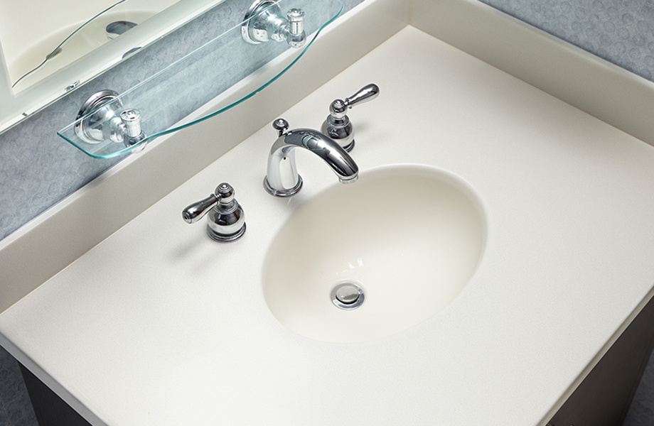 Bathroom sink and countertop in 757 Luna Sand acrylic solid surface with faucet and shelf