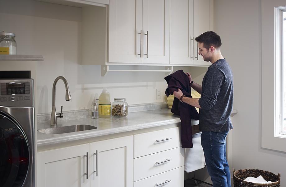 Gray Onyx man doing laundry