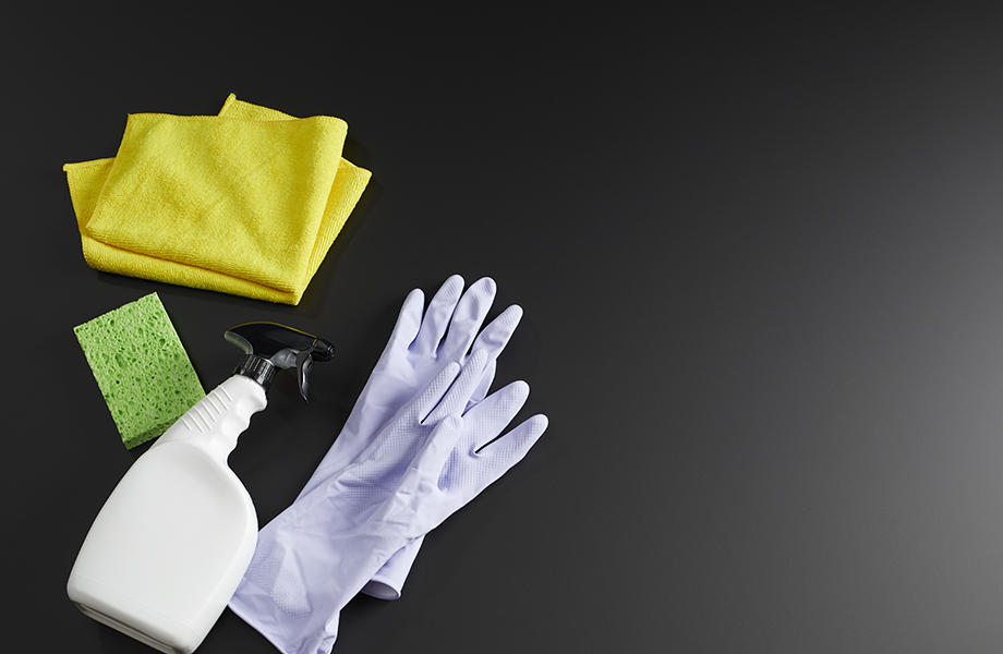 Gloves, sponge and cleaner on Formica Infiniti Counter