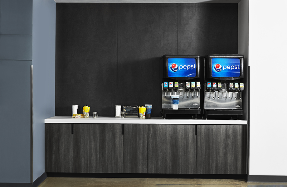 Self-service soda fountain with M9422 Black Patina metallic wall, 5792 Inked Oak cabinets and 416 Luna Pewter white acrylic countertops