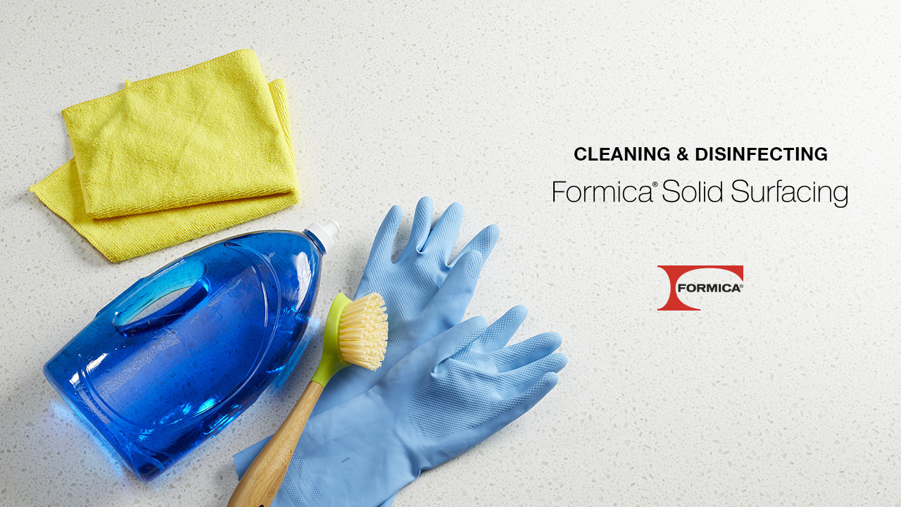 Formica solid surface cleaning with rag, gloves and soap
