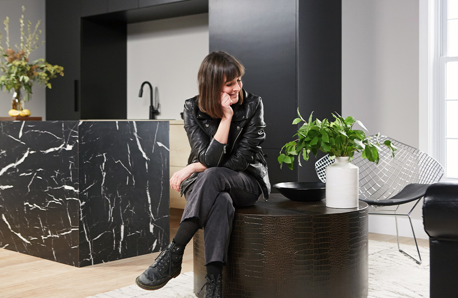 Leanne Ford, pictured here with an island covered in 7403 Nero Marquina 180fx® by Formica Group laminate, and a coffee table covered with 5624 Antique Black dECOLeather® Recycled Leather Veneer