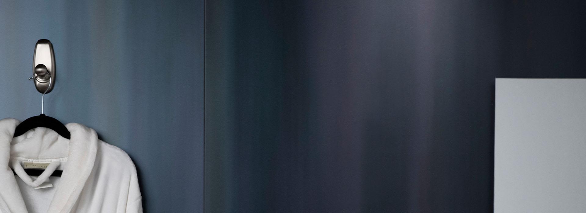 M9421 Dark Rolled Steel hotel suite bathroom with robe