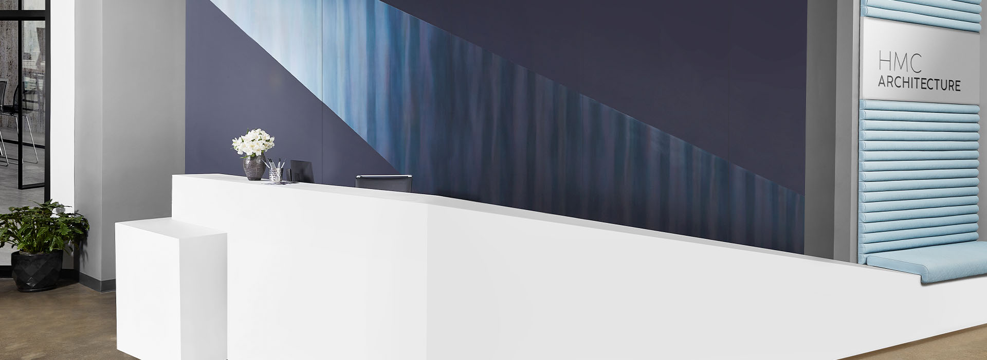 408 Luna Brite White reception desk with M9421 Dark Rolled Steel and 5323-AN Nocturne wall