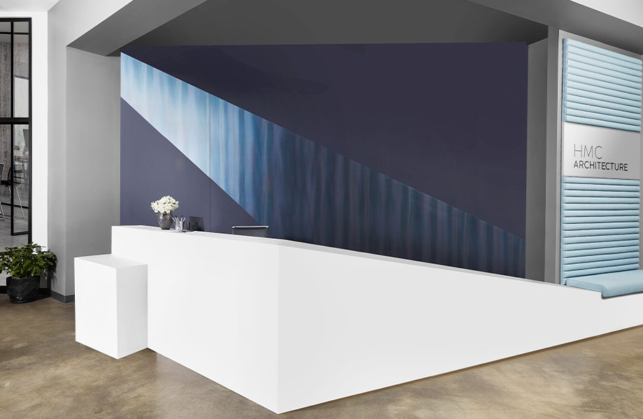 408 Luna Brite White reception desk with M9421 Dark Rolled Steel and 5323-AN Nocturne wall