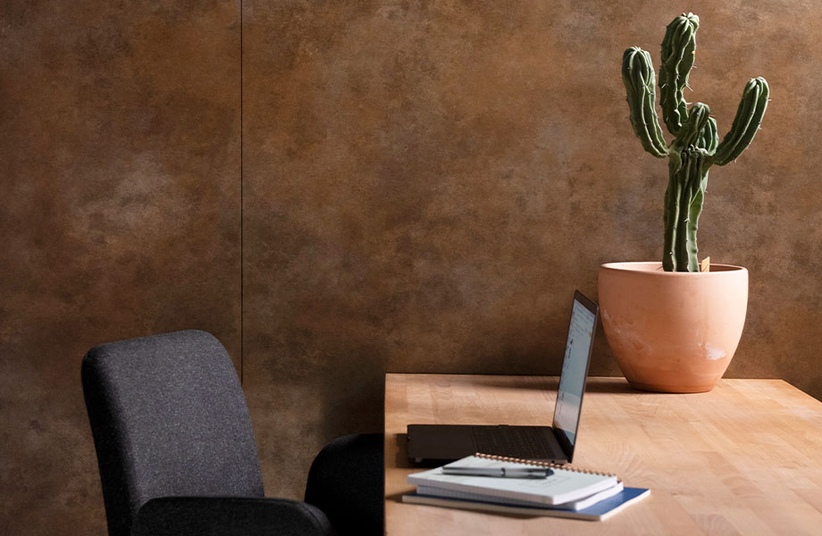 Office wall with M9423 Brass Patina metal panels near desk and cactus