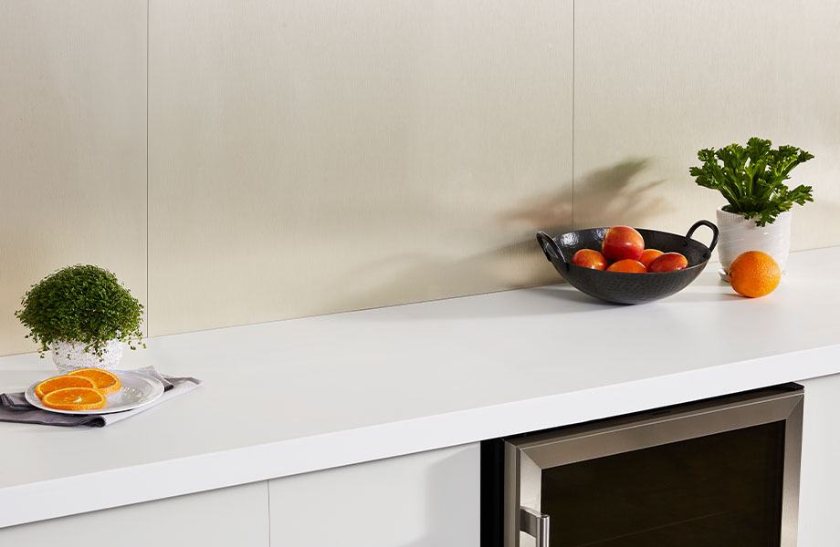 M9427 Champagne Stainless faux metal wall panels with white countertop and fruit bowl