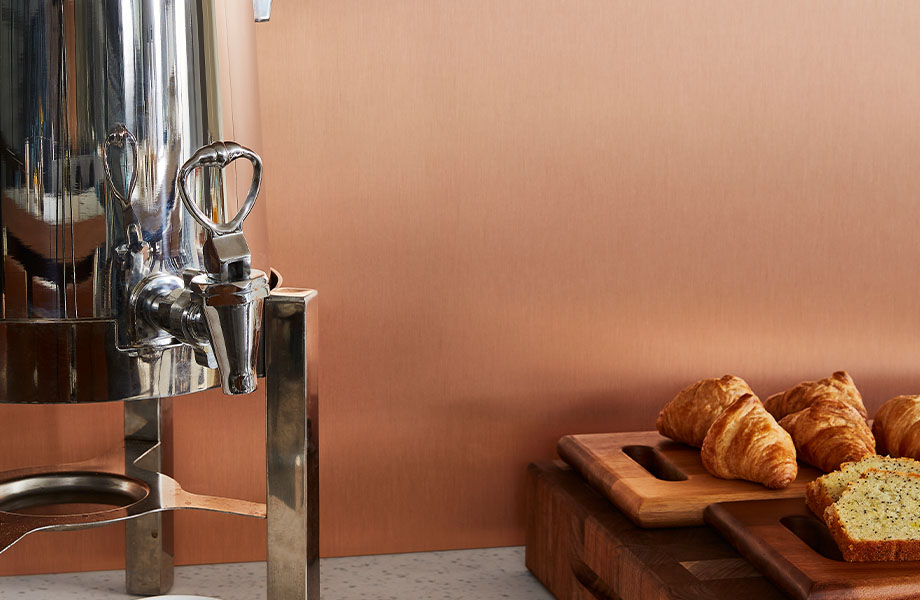 M9428 Copper Stainless wall panel with coffee and pastries on counter