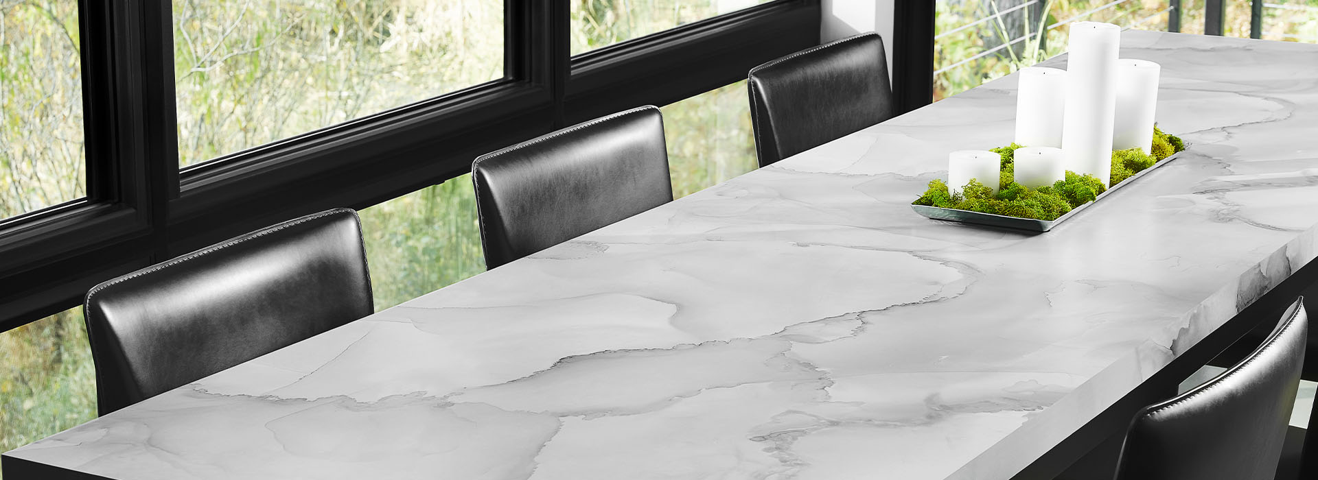 5016 Watercolor Porcelain 180fx® Laminate gives the look of gray marble on dining room table surrounded by chairs