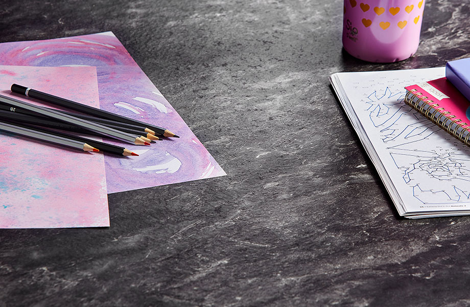 5019 34 Black Bardiglio and 6903 90 Cassis desk with pencil and paper