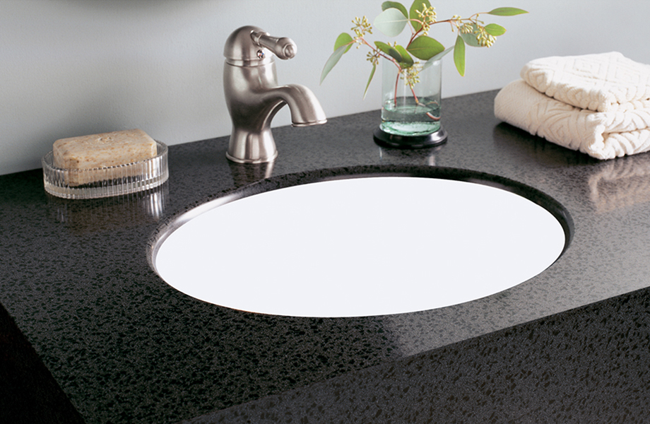 Bathroom sink with soap and plant L075 501 Black Lava Formica Solid Surfacing
