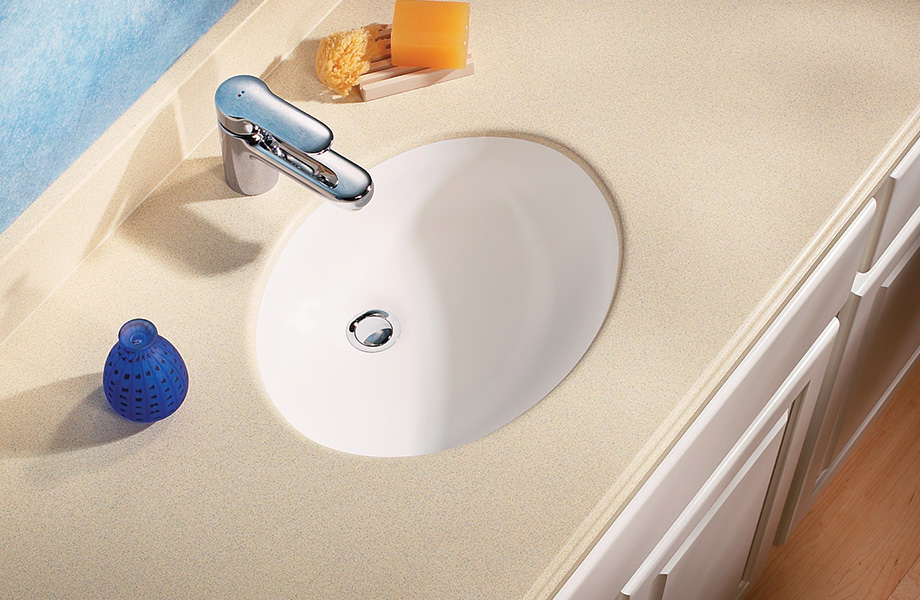 Bathroom sink with soap and blue vase V065 Formica Solid Surfacing