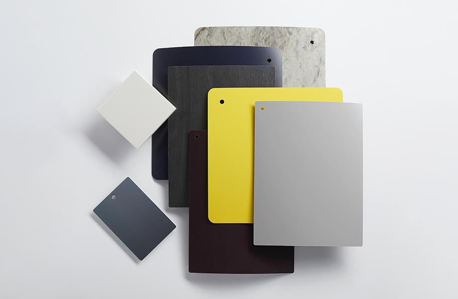 Colección de muestras de laminado Formica en azul, amarillo y gris