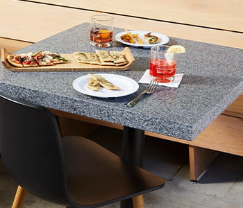411 Grafite Terrazzo Matrix Restaurant dining table with appetizers and drinks